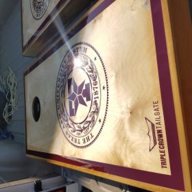 The Texas A&M University Seal Cornhole Board